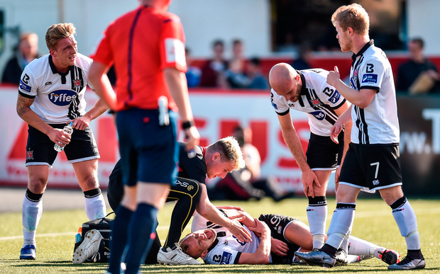 Dean Shiels of Dundalk lies injured after scoring his side's first goal
