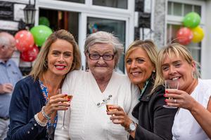 Mary O'Reilly (72) from Beaumont with her daughters Deirdre,Fiona and Orla after she came home to a heroes welcome from family and neighbours after surviving Covid and having spent 19 weeks in hospital from January,  Pic:Mark Condren