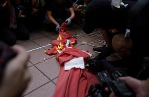 An anti-government protester burns a Chinese flag in Tuen Mun, Hong Kong, China September 21, 2019. REUTERS/Aly Song