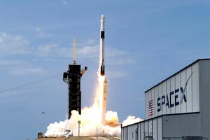 A SpaceX Falcon 9, with NASA astronauts Doug Hurley and Bob Behnken in the Dragon crew capsule, lifts off from Pad 39-A at the Kennedy Space Center in Cape Canaveral. (AP Photo/John Raoux)