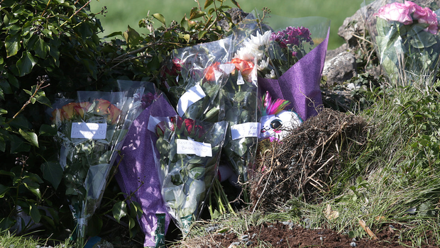 Flowers left at the scene of the crash.