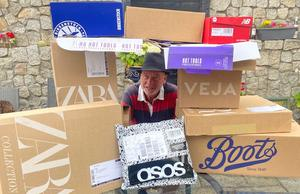 BOOT THE BOXES: Liam Collins is dwarfed by cardboard Photo: Hannah Collins