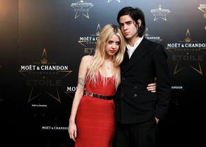 Peaches Geldof (L) and Thomas Cohen pose for photographers at the Moet & Chandon Etoile Award for Mario Testino at the Park Lane Hotel in London, England