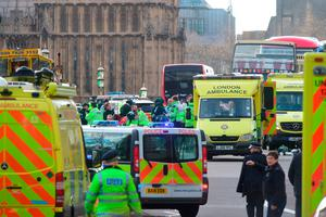 Emergency personnel on Westminster Bridge, close to the Palace of Westminster, London, after at least two people have died after a knifeman brought terror to the heart of Westminster, mowing down pedestrians then stabbing a policeman before he was shot by armed officers. Picture: Lauren Hurley/PA Wire