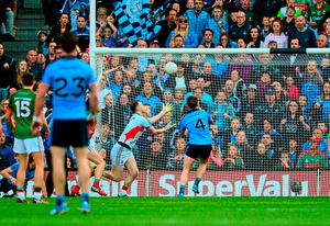 Philip McMahon, Dublin, scores a second half goal past Mayo goalkeeper Rob Hennelly