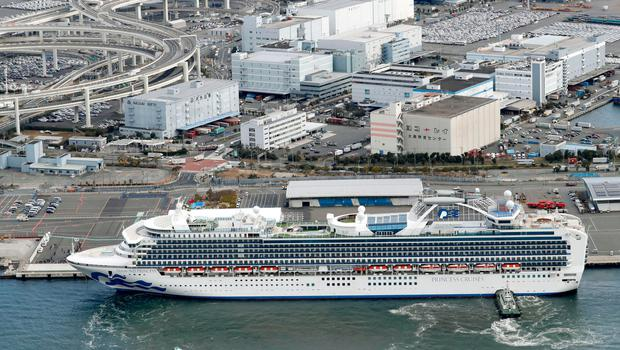 The cruise ship Diamond Princess is anchored at Yokohama Port for supplies replenished in Yokohama, south of Tokyo, Thursday, Feb. 6, 2020. . (Kenzaburo Fukuhara/Kyodo News via AP)