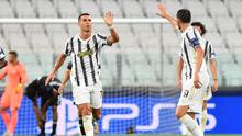 Juventus' Cristiano Ronaldo celebrates scoring their second goal with teammates in the Champions League Round of 16 second leg match against Olympique Lyonnais in Turin, Italy