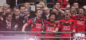 Gibson with Gary Neville and Ji-Sung Park after the 2010 League Cup final .Photo: John Peters/Manchester United via Getty Images