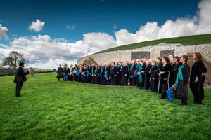 A small group of choristers sung the first verse a capella, before joining the rest of their ranks outside for the second verse. Picture: Ken Williams