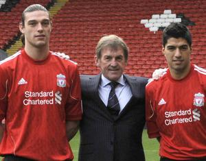 Kenny Dalglish with Andy Carroll and Luis Suarez. Picture: REUTERS/Nigel Roddis