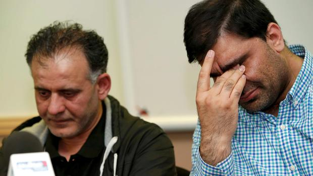 Akhtar Iqbal (L), the husband of Sugra Dawoodman and Mohammed Shoaib, the husband of Khadija Bibi dawood react during a news conference at a solicitors office in Bradford, Britain, June 16, 2015.  REUTERS/Andrew Yates
