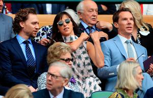 Tom Hiddleston, Sophie Hunter and Benedict Cumberbatch on day thirteen of the Wimbledon Championships at the All England Lawn Tennis and Croquet Club, Wimbledon. Sunday July 14, 2019. Mike Egerton/PA Wire.
