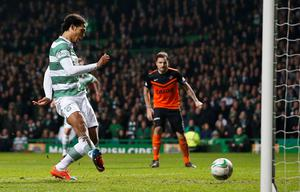 Virgil van Dijk scores Celtic's fourth goal in their Scottish Cup quarter final replay win over Dundee United on Wednesday night