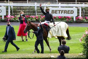 Frankie Dettori celebrates after winning the Gold Cup on Stradivarius. Julian Finney/Pool via REUTERS