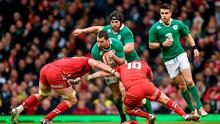 14 March 2015; Rob Kearney, Ireland, is tackled by Taulupe Faletau, left, and Dan Biggar, Wales. RBS Six Nations Rugby Championship, Wales v Ireland, Millennium Stadium, Cardiff, Wales.  Picture credit: Brendan Moran / SPORTSFILE