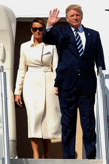 US President Donald Trump (R) waves as he and First Lady Melania Trump (L) disembark Air Force One upon arrival at Shannon Airport in Shannon, County Clare, Ireland on June 5, 2019