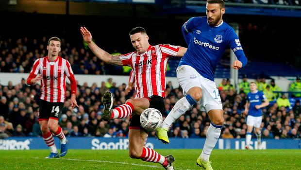 Lincoln City's Jason Shackell attempts to block a shot from Everton's Cenk Tosun. Photo: Andrew Yates/Reuters
