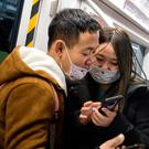 Care: Subway passengers in Beijing wearing masks. Photo: Getty Images