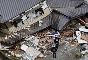 This aerial photo shows collapsed houses after a strong earthquake hit Hakuba, Nagano prefecture, central Japan, Sunday, Nov. 23, 2014