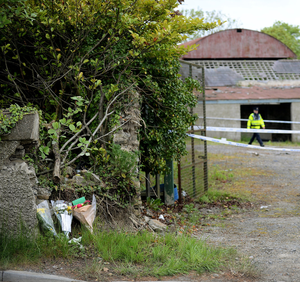 Floral tributes outside the derelict farm building where Ana's body was found