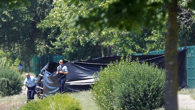 French Gendarmes stand guard next to a black plastic sheet outside a gas company site at the industrial area of Saint-Quentin-Fallavier, near Lyon
