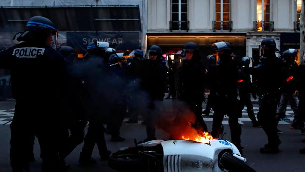 """A motorcycle burns during a demonstration by the """"yellow vests"""" movement at Boulevard Saint Germain in Paris, France, January 5, 2019. REUTERS/Gonzalo Fuentes"""