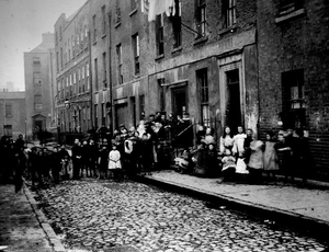 Contagion city: The residents of one Dublin slum house photographed in the early 1900s. Today's slum landlords have packed them in at up to 16 per bedroom