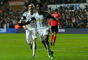 Swansea striker Wilfried Bony (r) celebrates with Chico Flores after scoring the third goal