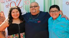 """Actress Raini Rodriguez, father Roy Rodriguez, and actor Rico Rodriguez attend the world premiere of """"The Wizard Of Oz 3D"""" at the grand opening of the TCL Chinese Theatre IMAX at TCL Chinese Theatre on September 15, 2013 in Hollywood, California.  (Photo by Michael Tullberg/Getty Images)"""