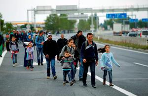 Migrants walk on a highway towards Vienna, near Nickelsdorf. The train link between Austria and Hungary will remain closed through the weekend