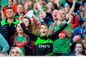 5 September 2015; Mayo supporters celebrate after Cillian O'Connor scored his side's first goal. GAA Football All-Ireland Senior Championship Semi-Final Replay, Dublin v Mayo. Croke Park, Dublin. Picture credit: Paul Mohan / SPORTSFILE