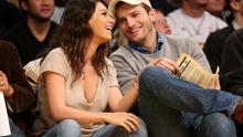 Actors Ashton Kutcher and Mila Kunis at a basketball game in December