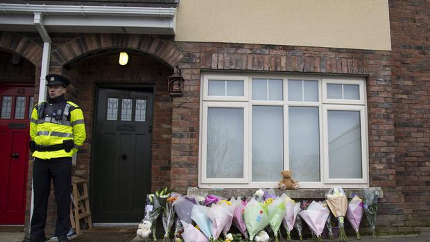SHOCK: Flowers left outside the house at Parsons Court. All news photos: Fergal Phillips