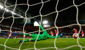 David De Gea can't prevent N'Golo Kante's shot from going past him for Chelsea's winning goal. REUTERS