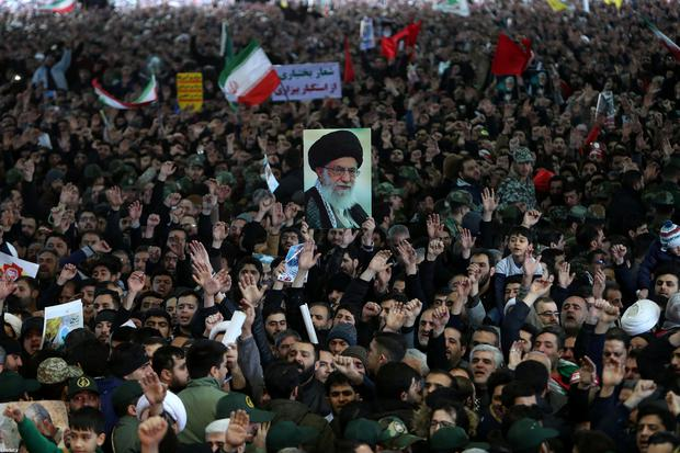 Iranian people carry pictures of Iran's Supreme Leader Ayatollah Ali Khamenei during a funeral for Iranian Major-General Qassem Soleimani, head of the elite Quds Force, and Iraqi militia commander Abu Mahdi al-Muhandis, who were killed in an air strike at Baghdad airport, in Tehran, Iran January 6, 2020. Official Khamenei website/Handout via REUTERS