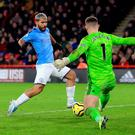 Manchester City's Sergio Aguero scores his side's winning goal in the Premier League clash with Sheffield United