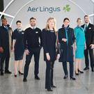 Designer Louise Kennedy pictured with Aer Lingus cabin crew (left to right) Byron Kumbula, Senior Cabin Crew; Eszter Dornfeld, Cabin Crew; Oisin Leong, Guest Experience Instructor; Louise Kennedy; Senior Cabin Crew; Aoife Costello, Cabin Service Manager; Vicoria Elmore, Senior Cabin Crew; David Rodgers, Senior Cabin Crew, at the unveiling of the new look Aer Lingus uniform. Photo: Leon Farrell / Photocall Ireland