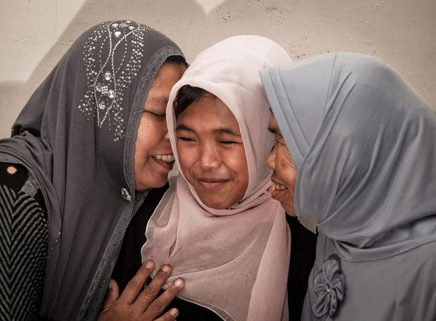 Jamaliah (left) gives a hug to her daughter Raudhatul Jannah after being reunited in Meulaboh, Aceh, northern Sumatra, Indonesia