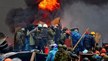 Anti-government protesters, continue to clash with police in Independence square, despite a truce agreed between the Ukrainian president and opposition leaders. Reuters