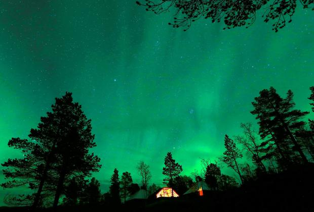 The Aurora Borealis (Northern Lights) seen over a mountain camp north of the Arctic Circle, near the village of Mestervik. REUTERS/Yannis Behrakis