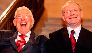 First Minister Ian Paisley and Deputy First Minister Martin McGuinness smiling after being sworn in as ministers of the Northern Ireland Assembly, Stormont. Photo: Paul Faith/PA Wire