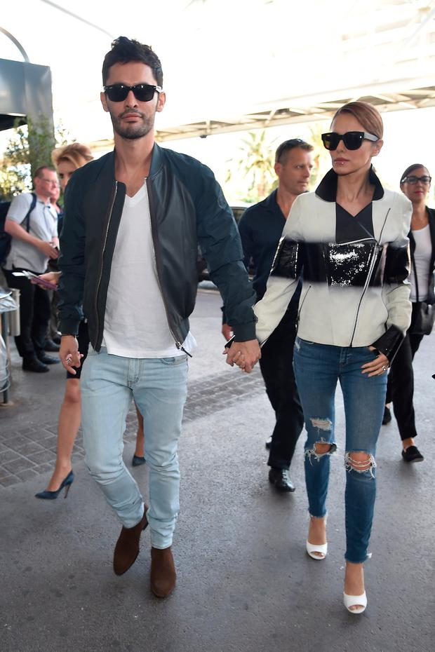 Jean-Bernard Fernandez-Versini and wife Cheryl Fernandez-Versini are seen at Nice airport during the 68th annual Cannes Film Festival on May 16, 2015 in Cannes, France. (Photo by Marc Piasecki/GC Images,)