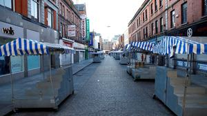 FILE PHOTO: The Moore street market empty, as the spread of the coronavirus disease (COVID-19). REUTERS/Jason Cairnduff/File Photo