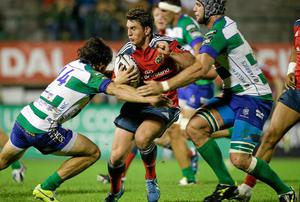 Ian Keatley takes on the Treviso defence. Roberto Bregani / SPORTSFILE