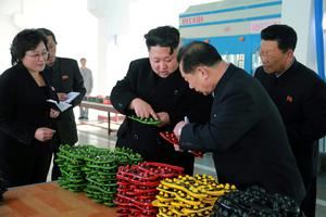 North Korean leader Kim Jong Un (C) provides field guidance to the Ryuwon Shoes Factory in this undated photo released by North Korea's Korean Central News Agency (KCNA) in Pyongyang
