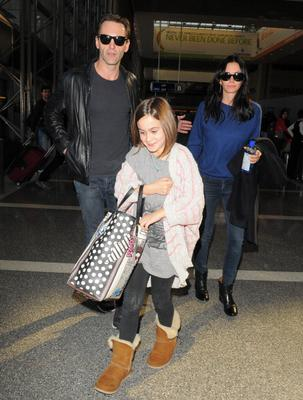 LOS ANGELES, CA - FEBRUARY 14: Courteney Cox, Johnny McDaid, and daughter Coco Arquette are seen at LAX airport on February 14, 2014 in Los Angeles, California.  (Photo by GVK/Bauer-Griffin/GC Images)