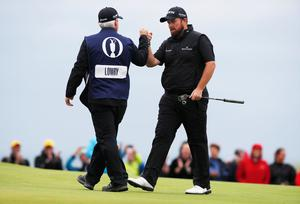 Golf - The 148th Open Championship - Royal Portrush Golf Club, Portrush, Northern Ireland - July 21, 2019  Republic of Ireland's Shane Lowry celebrates with his caddie after scoring a birdie on the 15th hole during the final round  REUTERS/Paul Childs