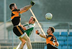 Barry Shanahan, left, and Pa McCarthy, Austin Stacks, in action against Niall Allen, Ballincollig. Picture credit: Diarmuid Greene / SPORTSFILE