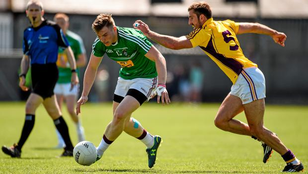 14 June 2015; Kieran Martin, Westmeath, in action against Brian Malone, Wexford. Leinster GAA Football Senior Championship Quarter-Final, Westmeath v Wexford. Cusack Park, Mullingar, Co. Westmeath. Picture credit: Paul Mohan / SPORTSFILE