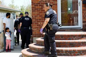 A resident allows NYPD officers to search in his house for the weapon used to shoot New York City plainclothes police officer Brian Moore at the Queens Village, in New York May 3, 2015. REUTERS/Eduardo Munoz